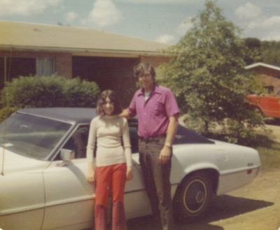 Dad and I in front of moms white thunderbird about 1973