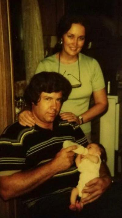 Dad feeding Marie with mom 1980