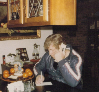 Dad on phone in Boaz house - Apr 1983