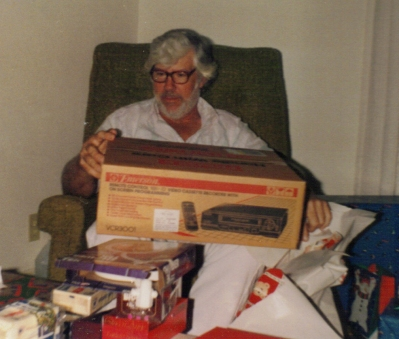 Dad opening VCR at Christmas 1992