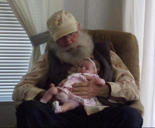 Papa looking at his great granddaughter