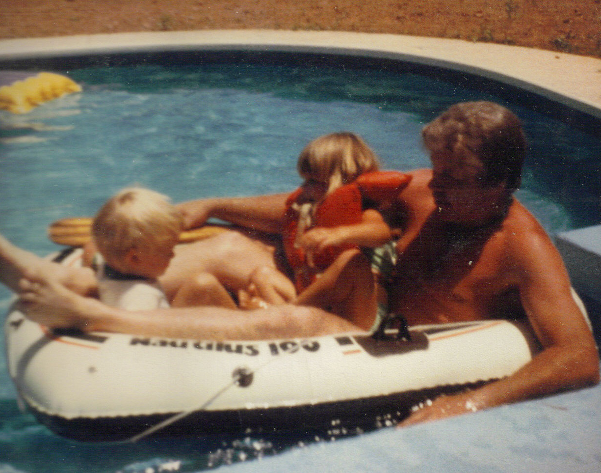Dad in boat in the pool with Marie and Matt 1983