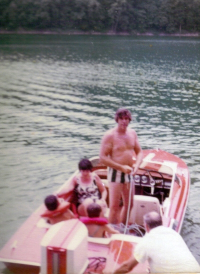 Dad in our Glastron boat at Sutton Lake with family