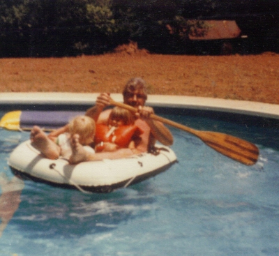 Dad Marie and Matt boating in the pool